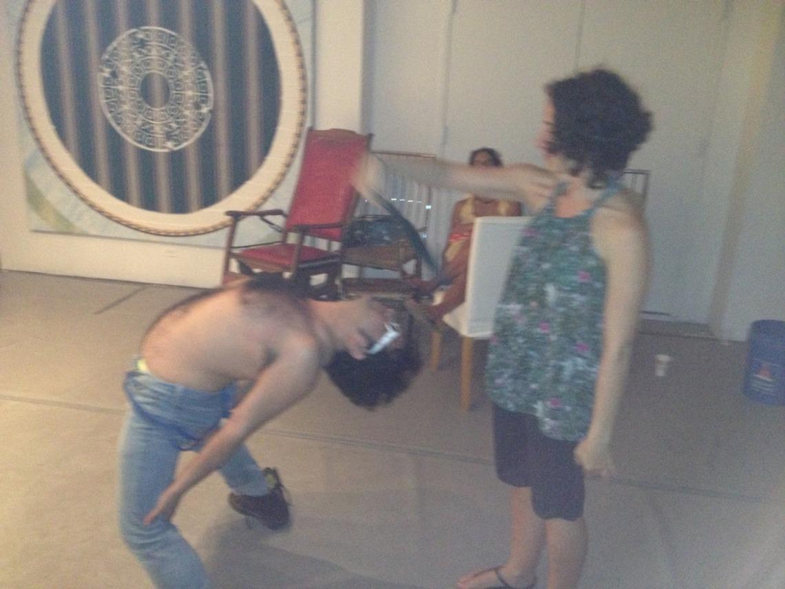 Bending over backwards at John Downing Bonafede's Psychlotron.